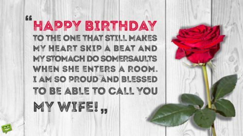 Romantic Birthday Wish for my wife on image of red rose on a white wooden table.