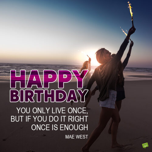 Inspirational birthday wish on image of women holding torches and celebrating on the beach.