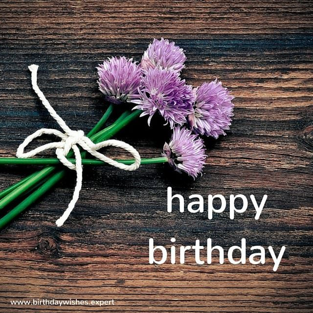happy birthday image with wild flowers.