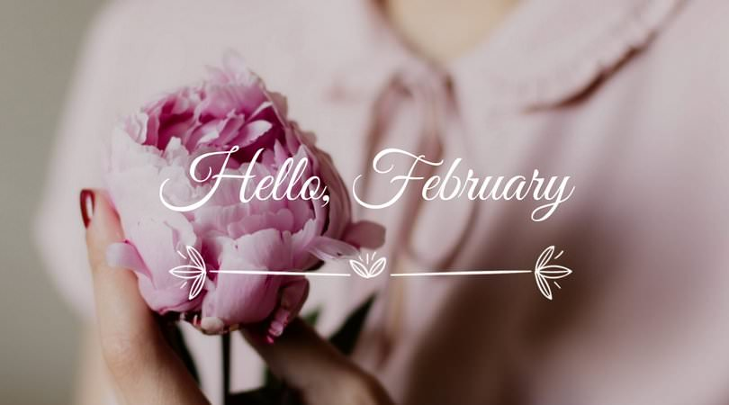 Hello-February-on-nostalgic-pic-with-woman-holding-pink-rose.jpg